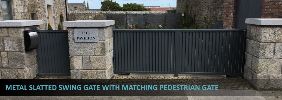 Metal slatted swing gates with matching pedestrian gate